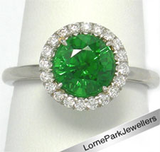 Green gem Platinum ring 2.40 Ct with .30 Ct diamond cluster at Lorne Park Jewellers.